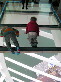 2 boys looking through glass floor builders bottoms buttocks exposed