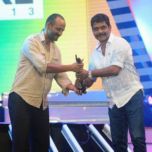 Kishore presents Best Film (Malayalam) award to Antony Perumbavoor for the film Drishyam during the 61st Idea Filmfare Awards South, held at Jawaharlal Nehru Stadium in Chennai, on July 12, 2014.