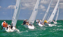J/22s sailing around mark at Cayman Islands invitational