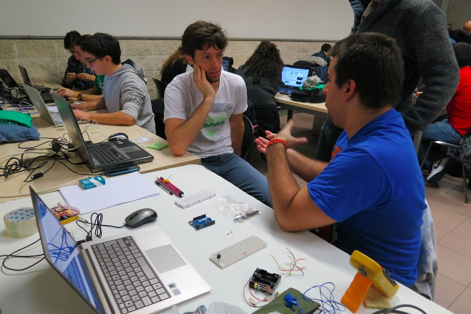 Chris George talks with team at the Roma hackthon