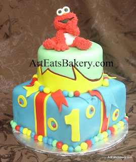 Kid's Elmo 1st birthday cake with circles and fondant balls design