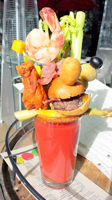 The Bloody Marys at Todd English PUB on Sat and Sun are outrageous in Las Vegas. This one is the All About Mary with choice of vodka, Todd's Sinful Blend, stacked with a slider, crispy chicken wing, chilled shrimp, corn dog pup, stuffed olives, cleery, carrot and pickled asparagus