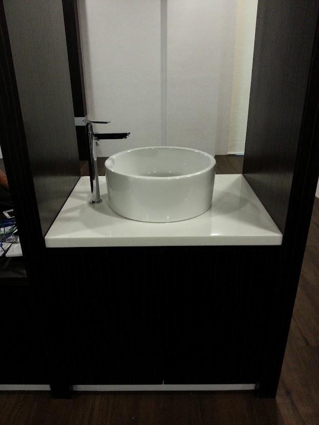 ceramic basin at cabinet