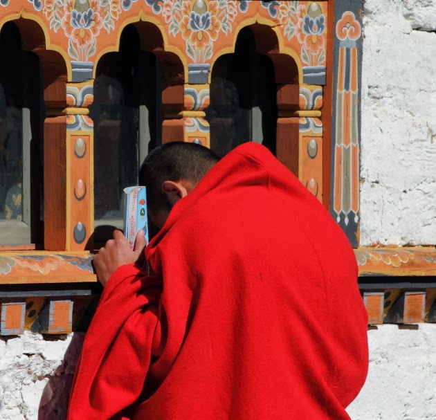 Monk prays at Simtokha Dzong, Bhutan