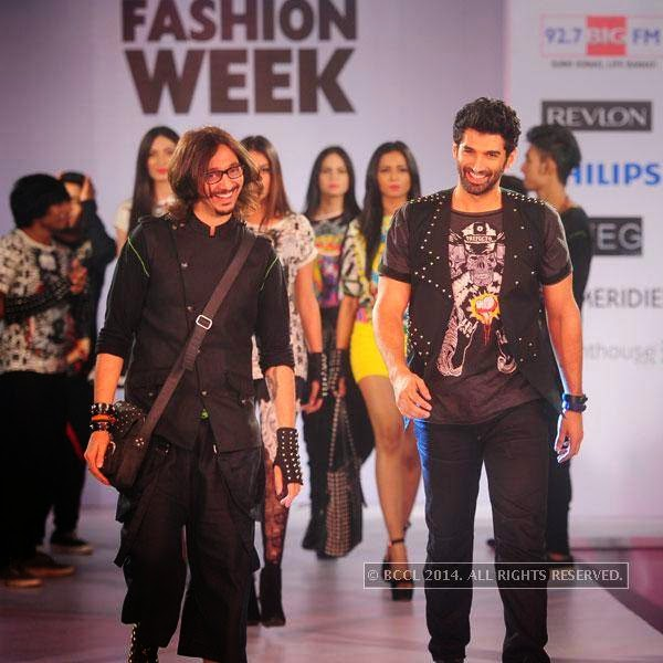 Nitin Bal Chauhan and Aditya Roy Kapoor walk the ramp during Jabong Online Fashion Week, held at Hotel Le Meridian, in Delhi, on July 30, 2014.