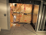 Added sound deadening and fiberglass insulation behind the refrigerator.