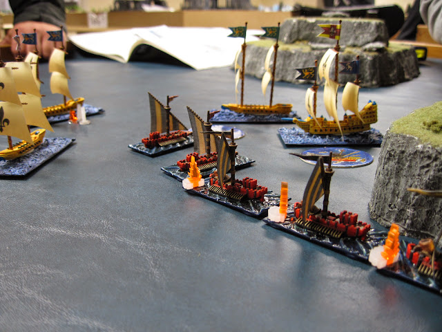 Iron Fists hit the center corsair once, doing some minor damage. The Galleon also sinks the annoying War Galley on its port.