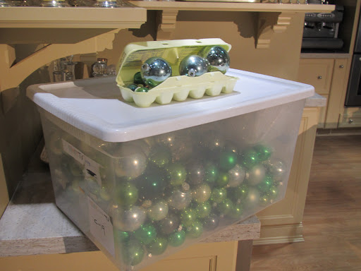Shatterproof balls can be stored in a big pile, seen here! - delicate ornaments are better off in egg cartons or wrapped in tissue paper.