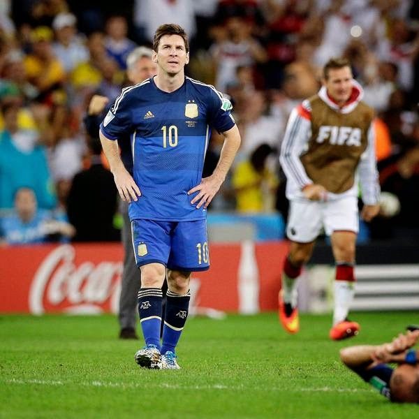 Argentina's Lionel Messi walks over the pitch after the World Cup final soccer match between Germany and Argentina at the Maracana Stadium, in Rio de Janeiro, on July 13, 2014.
