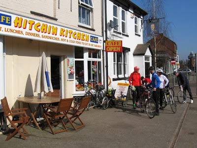 cyclists in front of cafe