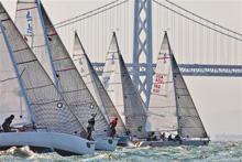 J/105 one-design sailboat- fleet starting upwind