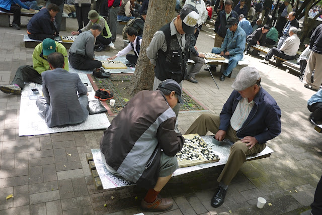 two men playing baduk (Go) at a park in Seoul