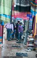 Dilli Haat - A happening place in Capital City of India (Delhi) : Also popular for handicrafts of various Indian States !!! : Posted by VJ SHARMA on www.travellingcamera.com : Dilli Haat is a nice place to hang out in Delhi... Its a place having various options of food and craft items. It's  near to the All India Institute of Medical Sciences on Sri Aurobindo Marg, just opposite to INA Market on Sri Aurobindo Marg... There is another Dilli Haat at Netaji Subash Place which is near to Netaji Subash Place Metro Station. Dilli Haat has stalls representing each state of India which gives a complete variety of tastes available all over India. Check out some of the photographs from Dilli Haat near to INA Market !!! Lady moving towards a shop to buy some colorful bangles from Dilli Haat !!!Of course, this place is very popular among girls as there are lot of options for shopping... Be it colorful or glittering jewelery, ethnic dresses, some art-works to decorate houses etc.. This places has lot of options for shopping colorful stuff from various parts of India !!!  An Art-piece made up of Bamboo roots !!!Dilli Haat is great place to have some creative art pieces which are developed in various parts of India !!! There are some specific shops which belongs to various states of India like Jammu and Kashmir, Himachal Pradesh, Madhya Pradesh, Bihar, Andhra Pradesh etc... Stuff like Madhubani Paintings, Kullu Shwals, Pashmina Shwals from Kashmir etc...There are also stalls of crafts from a variety of cultural traditions of India. Dilli Haat, full of delhites and tourists !!!Although I don't have any photograph of eating joints there but its a good place to find out nice eatables.. One of my friend took me to a shop which is popular for fruit beer and my person experience was not that good :) But it's worth trying !!!As of now there are two Dilli Haats in Delhi and there are plans to open few more... Unlike the traditional weekly market, the village Haat, Dilli Haat is permanent !!! Some shops are permanent but other sellers are rotated usually for fifteen days.It was raining during my recent visit to Dilli Haat which is near to INA market.. As you can see the shops in background have temporary roofs, so it becomes difficult to manage during rains... Although most of the part of these shops are well maintained but they need extra care during monsoons...Key-chains !!! These keychains are made up of leather 'juttis/jootis' :)  My friend bought few of them for gifting them to his friends in Germany !! Lot of colorful stuff for home decoration @ Dilli Haat, Delhi, INDIA Lot of families also come to Dilli Haat during the weekend because children find this place good and they also have lot of options to buy something for their rooms or school !!!Small 'garvas' with coloful/glittering decorations @ Dilli HaatProducts offered may include rosewood and sandalwood carvings, embellished camel hide footwear, sophisticated fabric and drapery, gems, beads, brass-ware, metal crafts, and silk and wool fabrics. Shows promoting handicrafts and handlooms are held at the exhibition hall in the complex. There is a nominal entrance fee to shop at Dilli Haat.. If I remember correctly its 15 Rs and around 5 Rs for children...Girl buying cotton-candy just outside Dilli Haat @ INA, Delhi, INDIA