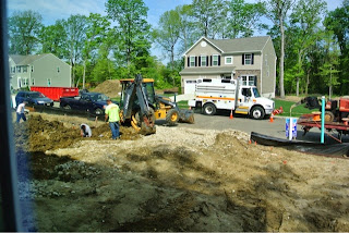 Picture of utility company running electric and gas line