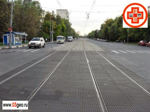 Фото поперечного профиля автомобильной дороги на пересечении с трамвайными путями в одном уровне после модернизации трамвайной линии в Москве. Заказать съемку поперечного профиля: +7 (926) 926-03-03, http://www.03geo.ru/