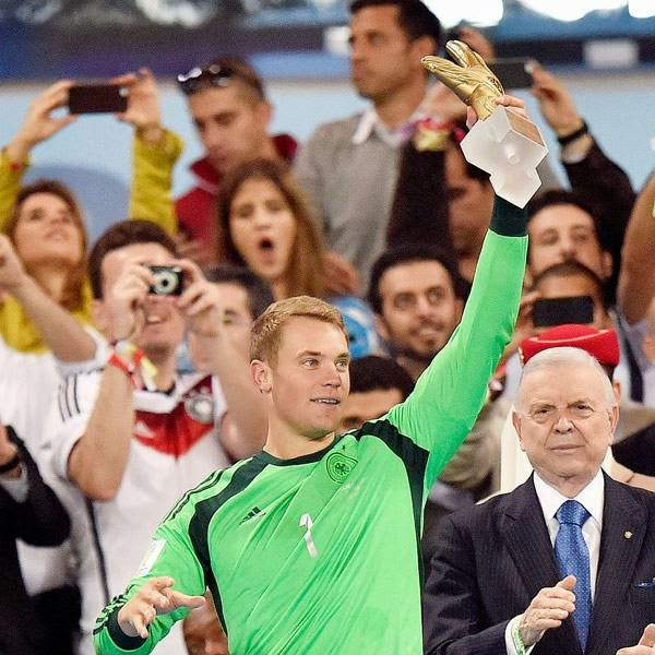 Germany's goalkeeper Manuel Neuer holds up the award for best goalkeeper after the World Cup final soccer match between Germany and Argentina at the Maracana Stadium in Rio de Janeiro, Brazil, Sunday, July 13, 2014.