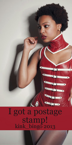 A person wearing a red and white leather corset and collar.
