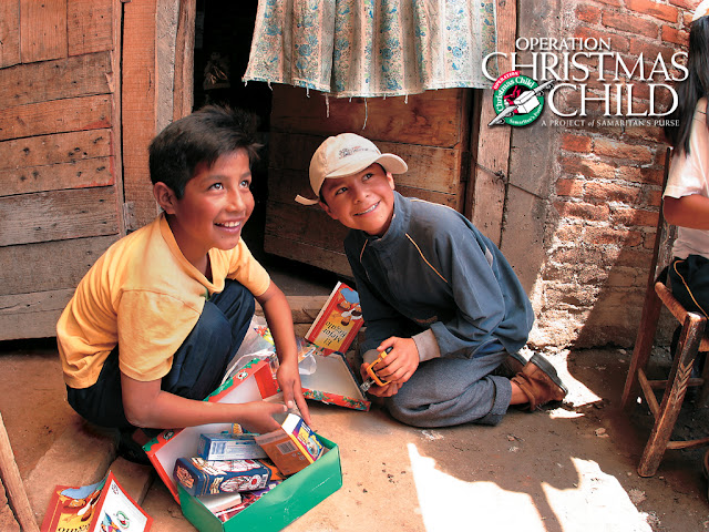 Boys with Operation Christmas Child shoeboxes