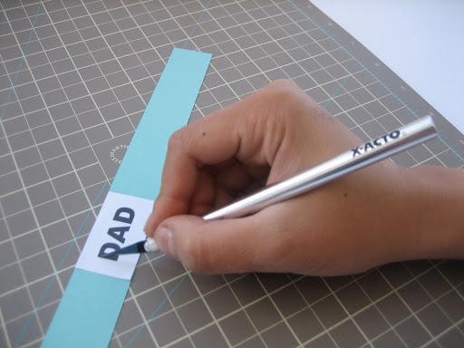 Usinga a craft knife, cut out the tops and sides of each letter.  Don't cut out the bottom edges.
