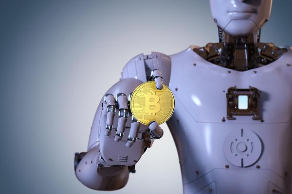 robot holding a piece of bitcoin
