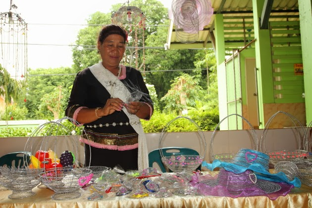 Tribal Woman making noodle strainers at Ban Dong Krathong Yam Village, Thailand