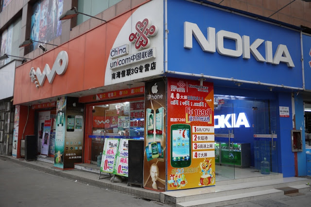 store with prominent signs for China Unicom and Nokia