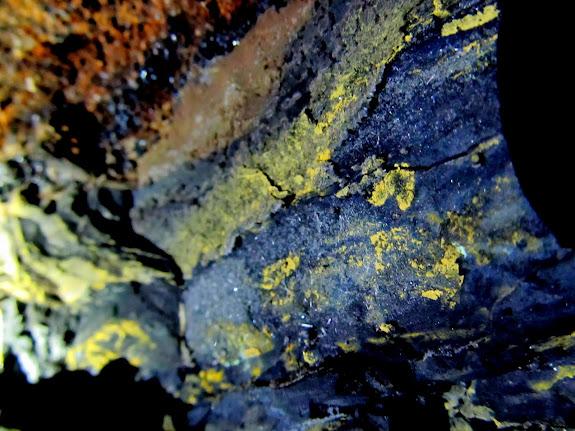 Yellow ore on top of coal deposits