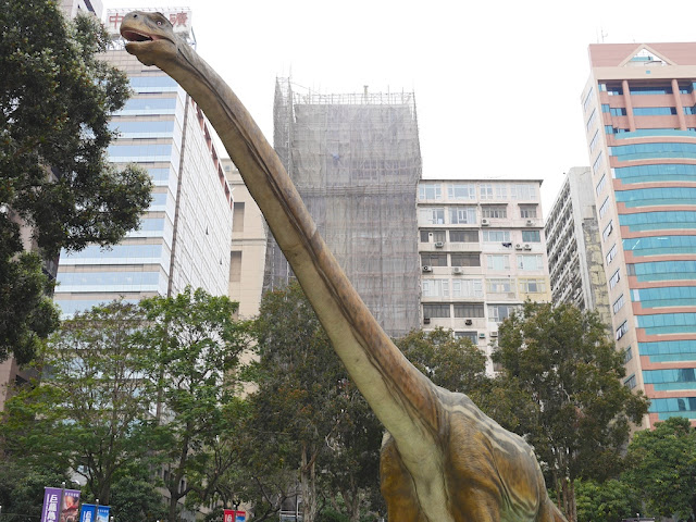large dinosaur outside the Hong Kong Science Museum
