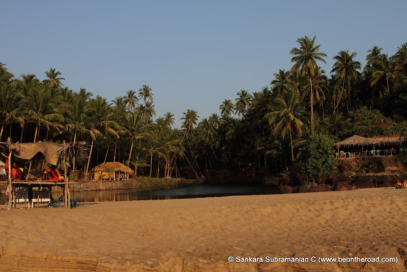 Huts facing the river and the sea at Cola beach