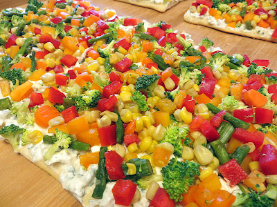 Summer Appetizer Recipe: Chilled Vegetable Pizza with dill/chive cream cheese mixture and broccoli, asparagus, baby carrots, red and orange bell peppers, corn kernels!