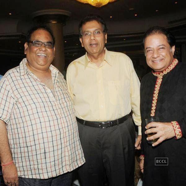 Satish Kaushik and Anup Jalota during the birthday celebrations, in Mumbai, on July 29, 2014. (Pic: Viral Bhayani)