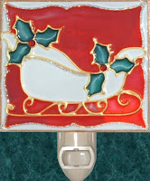 red and white sleigh with holly decor