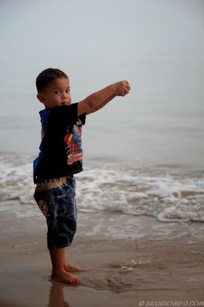 aslah main pasir pantai