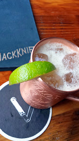 Jackknife PDX, their house cocktail option of Bonnie Parker cocktail with Old Taylor whiskey, toasted pecan, lime, honey, Jackknife ginger beer