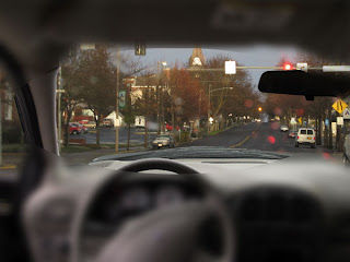 view of the street scene with blurred peripheral.  The view out the window of the front of the van remains unchanged