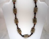 "Warmth=Smoky Quartz & Rhodonite - Grounding, dissolves negativity, psychic protection, health & spirital well-being.  18""  $35"