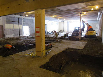 Trenches and footing holes in cafeteria