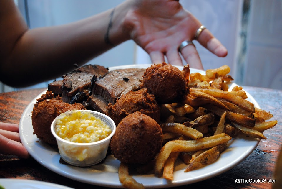 Beef brisket, hush puppies with an egg sauce, and fries
