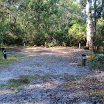 Open sandy area numbered campsites