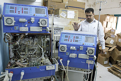 Shifa hospital, Gaza city. An engineer from the Ministry of Health in Gaza stands among broken haemodialysis machines. The lack of medical spare parts and medical equipment results in an inability to offer the most basic of diagnostic services in Gaza health facilities. © ICRC / I. El Baba