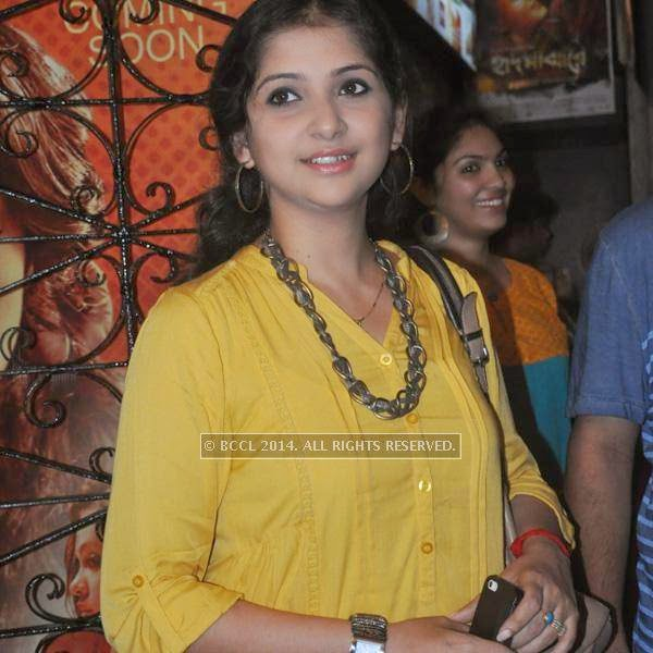 A guest during the premiere of Ranjan Ghosh's movie Hrid Majhare at Priya in Kolkata.