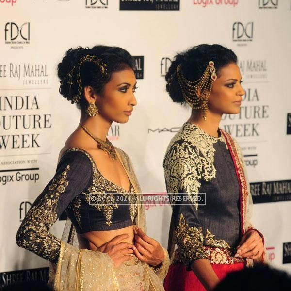 Lakshmi Rana and Noyonika pose for the camera for Anju Modi on Day 2 of India Couture Week, 2014, held at Taj Palace hotel, New Delhi.