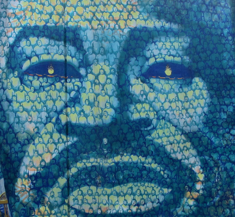 Image of Dr King made from hundreds of small figures in shades of blue/green.