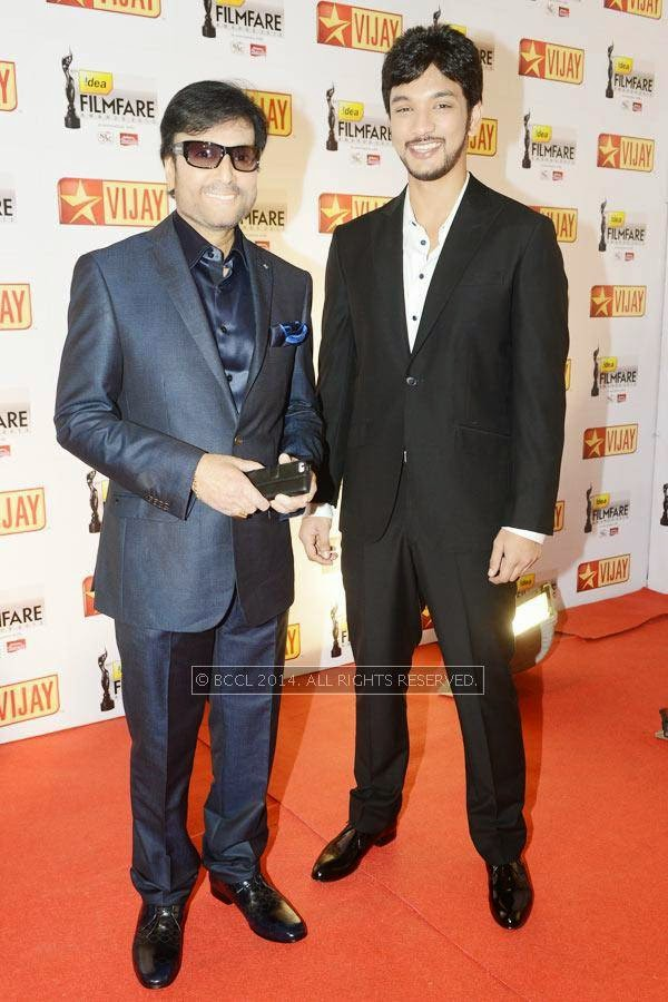Karthik arrives with his son Gautam at the 61st Idea Filmfare Awards South, held at Jawaharlal Nehru Stadium in Chennai, on July 12, 2014.