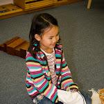 Montessori girl in Huntington Beach working on practical life skills.