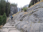 Series of steps along Mist Trail. Vernal Falls in the background.