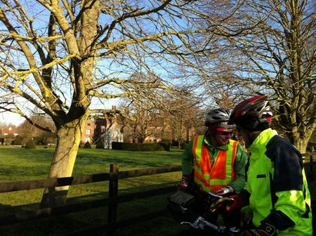 Two cyclists in front of Chenies manor house