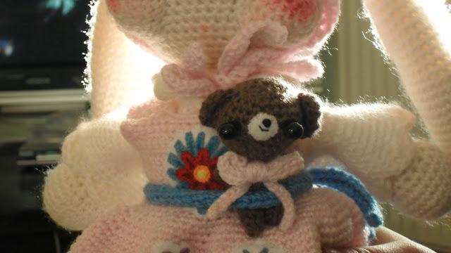 close up of Amigurumi rabbit's little bear