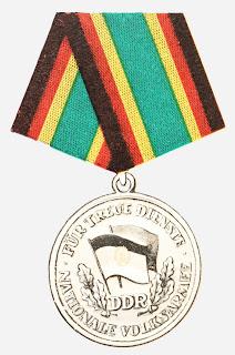 148f Medaille für treue Dienste in der Nationale Volksarmee für 20 Dienstjahre  www.ddrmedailles.nl