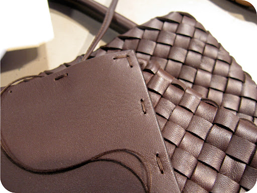 Close up of the hand stitched leather bottom piece of the Ebano Cabat.